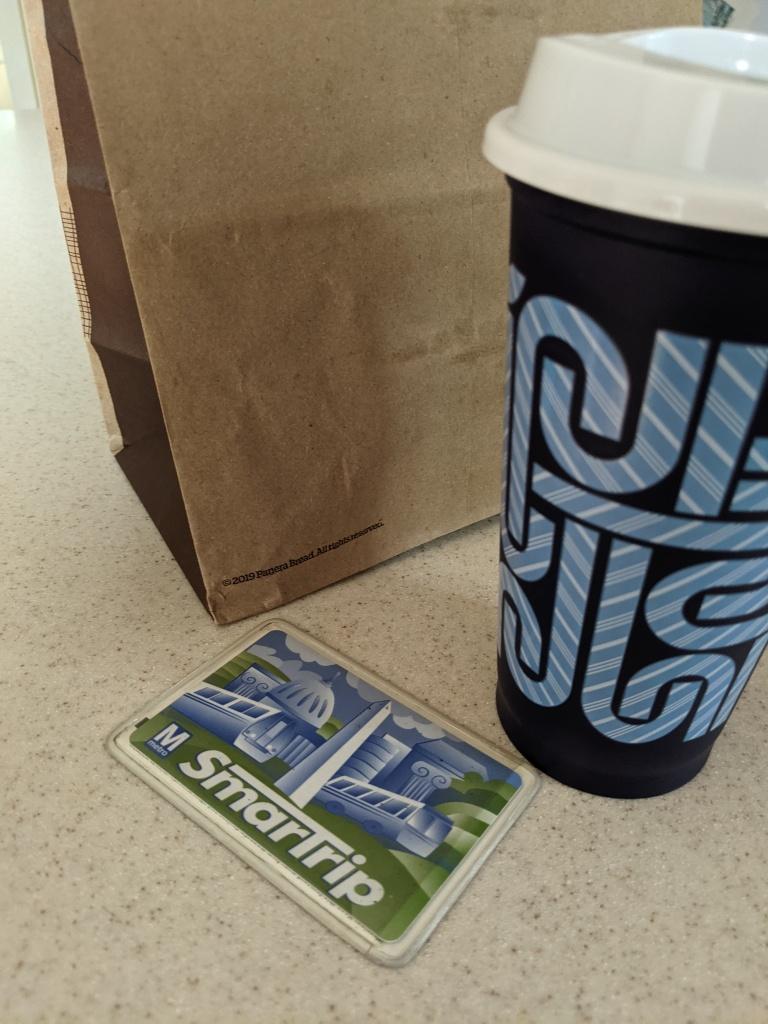 Paper bag, travel mug, smart trip metro card